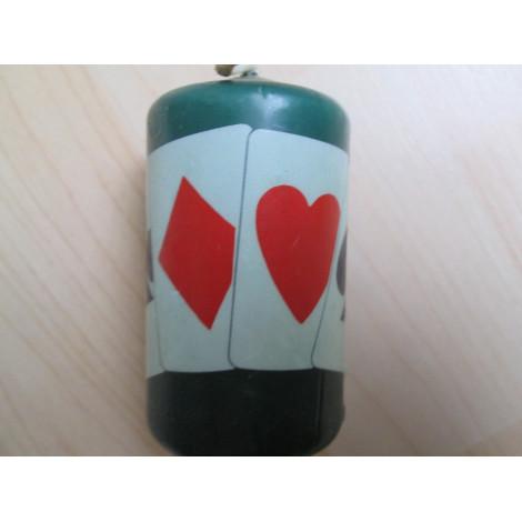 Kerze, klein, dick, grün mit grossen farbigen Symbolen